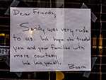USA, NYC. Sign in shop window after Hurricane Sandy